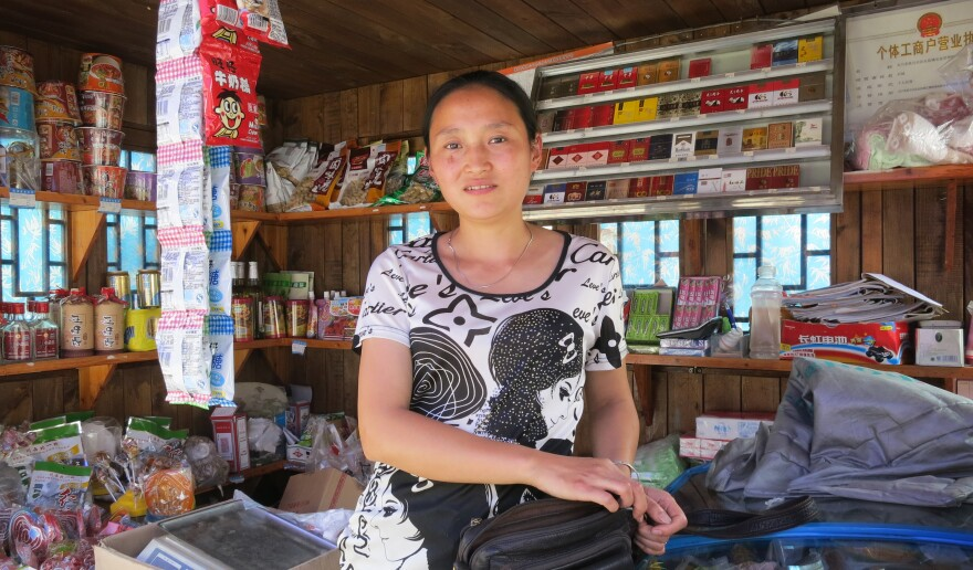 """Zhang Ming lost her 5-year-old daughter, her parents and her home in the 2008 Sichuan earthquake. She now operates a stall selling food and drinks, and she and her husband have another daughter. But life is difficult. """"We are facing the problem of how to survive, so we don't have time to think of anything else. If you have too much free time, you think about things too much."""""""