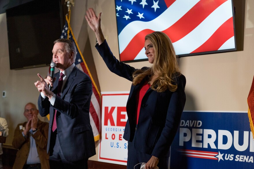 Sens. David Perdue and Kelly Loeffler speaks at a campaign event earlier this month. Both are competing in runoff elections in January that will determine which party controls the Senate.