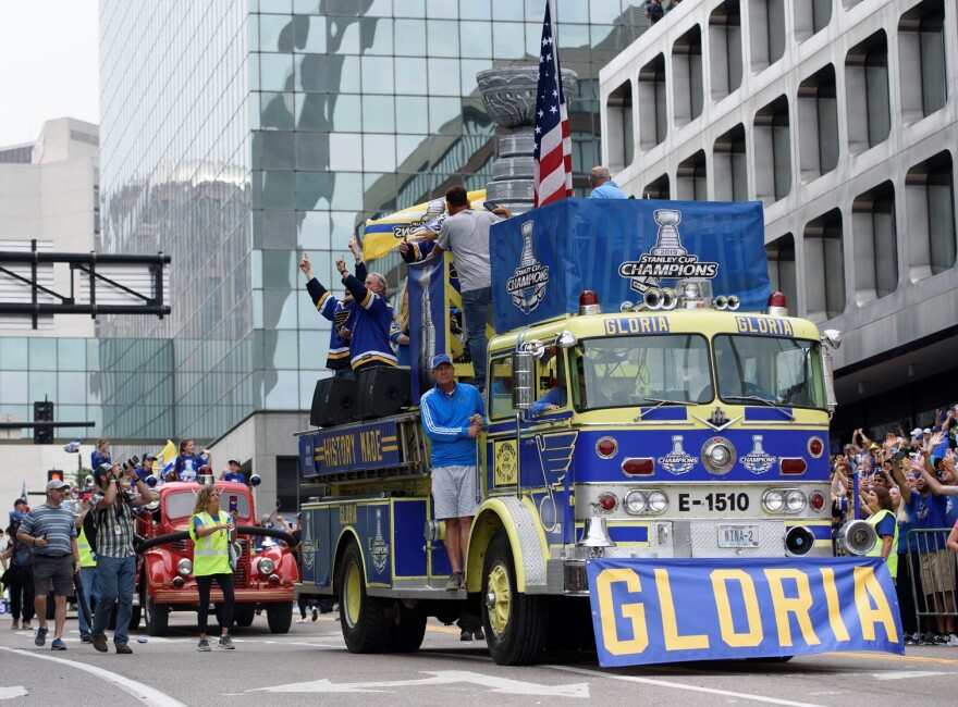 Floats and fire trucks make their way down Market Street during the Blues championship parade in downtown St. Louis on Saturday.