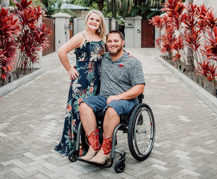 A few years after a motocross accident left him paralyzed, Kent Stephenson came to Louisville from his home in Texas to be part of an experimental treatment for spinal cord injuries that has helped him regain some motion. Stephenson is pictured here with his wife Misti. (Courtesy of Kent Stephenson)