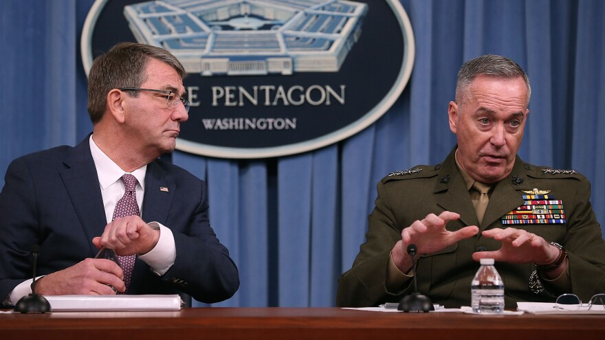 Secretary of Defense Ash Carter (left) says the Pentagon's new hacker program will strengthen America's digital defenses. Carter is seen here with the chairman of the Joint Chiefs of Staff, Gen. Joseph Dunford.