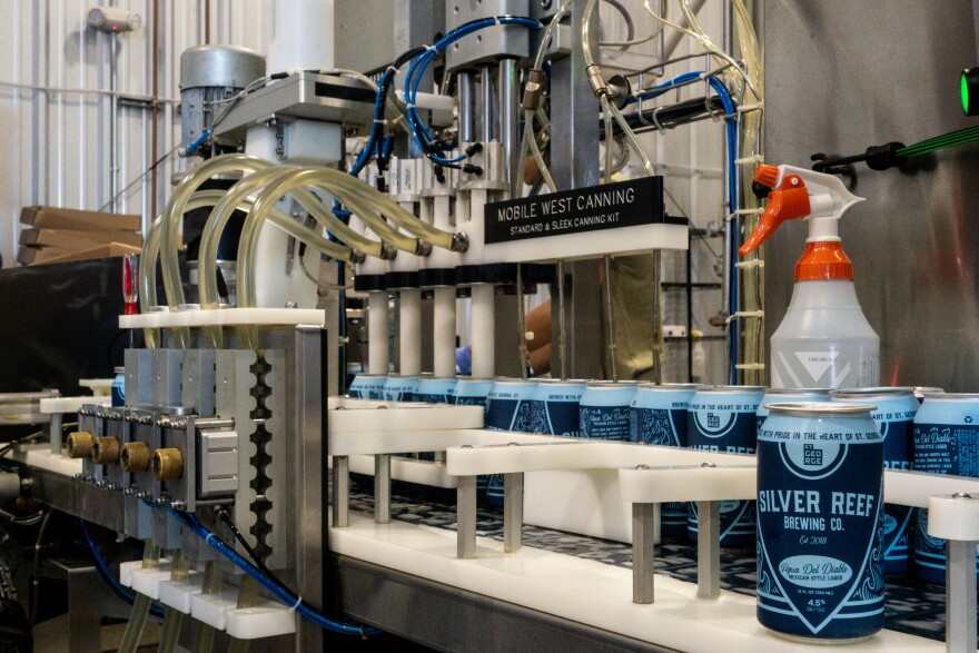 A mobile canning line fills beers cans at Silver Reef Brewing Co. in St. George.
