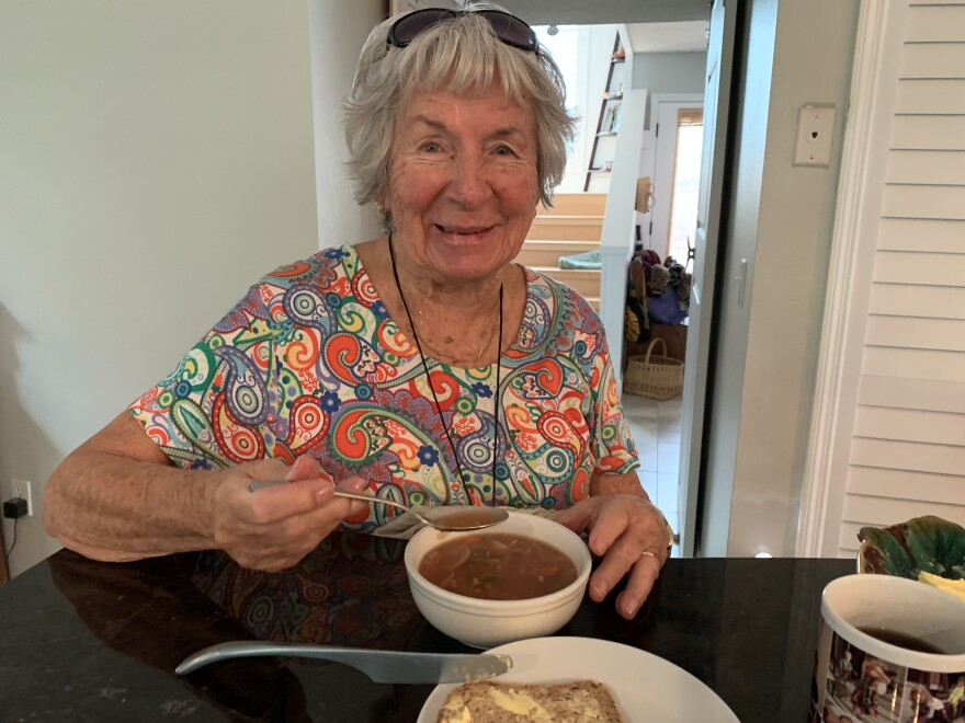 Olga Smith eats soup in the kitchen