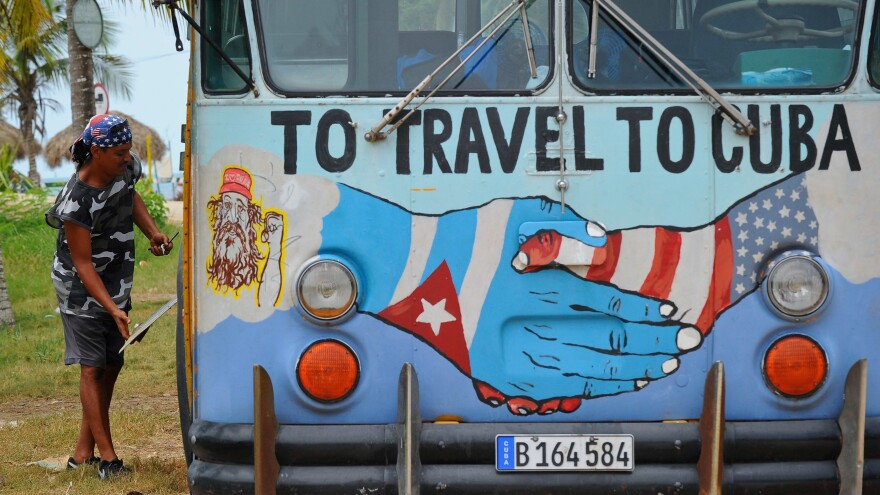 A bus with the Cuban and U.S. flags is seen on a beach in Havana earlier this month. The White House is exploring regulatory changes to provide new opportunities for American citizens and U.S. businesses in Cuba.