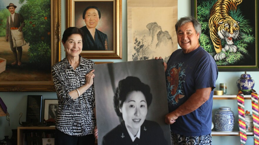 Siblings Christine Cuddy (left) and Flip Cuddy hold a photo of their mother, Susan Ahn Cuddy, the first Asian American woman in the Navy, at their StoryCorps interview in Northridge, Calif., last July.