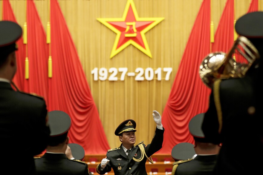 A military band conductor rehearses ahead of the ceremony at Beijing's Great Hall of the People on Tuesday. Chinese President Xi Jinping and many high-ranking officials celebrated the 90th anniversary of the People's Liberation Army with pomp and circumstance.