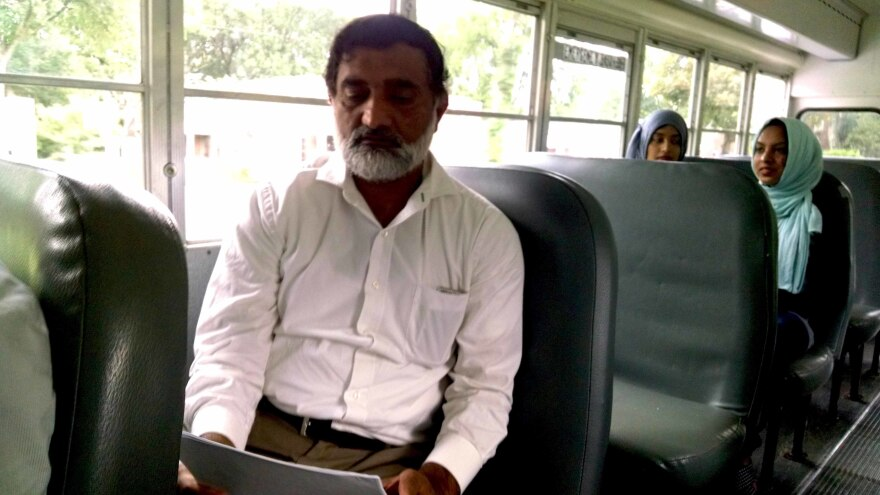 Hafiz Sibtain reviews a sample ballot as he rides a bus to early voting in Nashville.