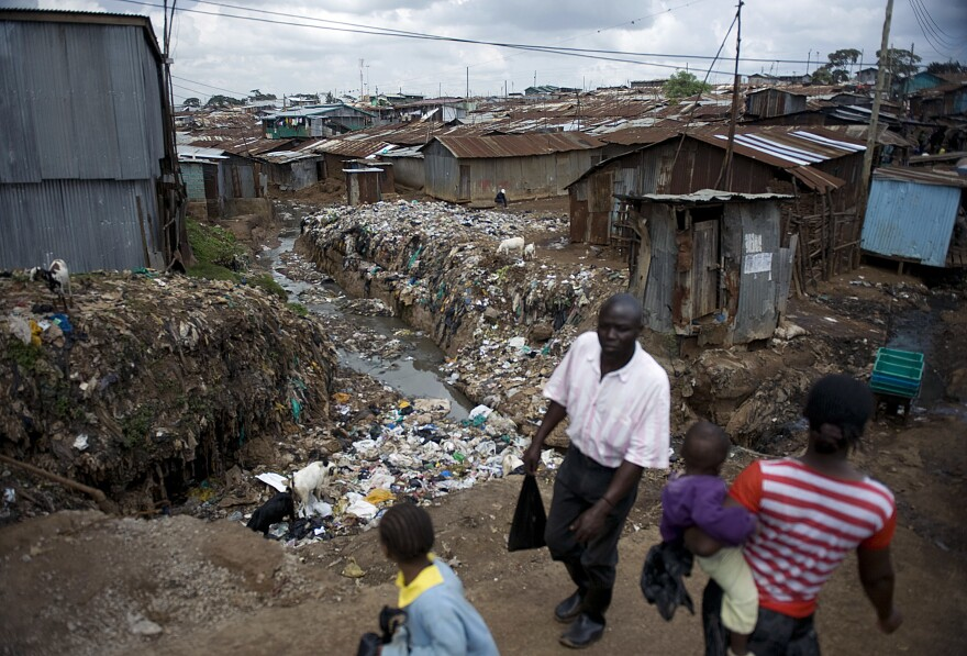 In Kibera, Kenya's biggest slum, plastic bags are found everywhere — on roofs, on walls and clogging drainage. The Kenyan government says an almost total ban on plastic bags will benefit the environment.