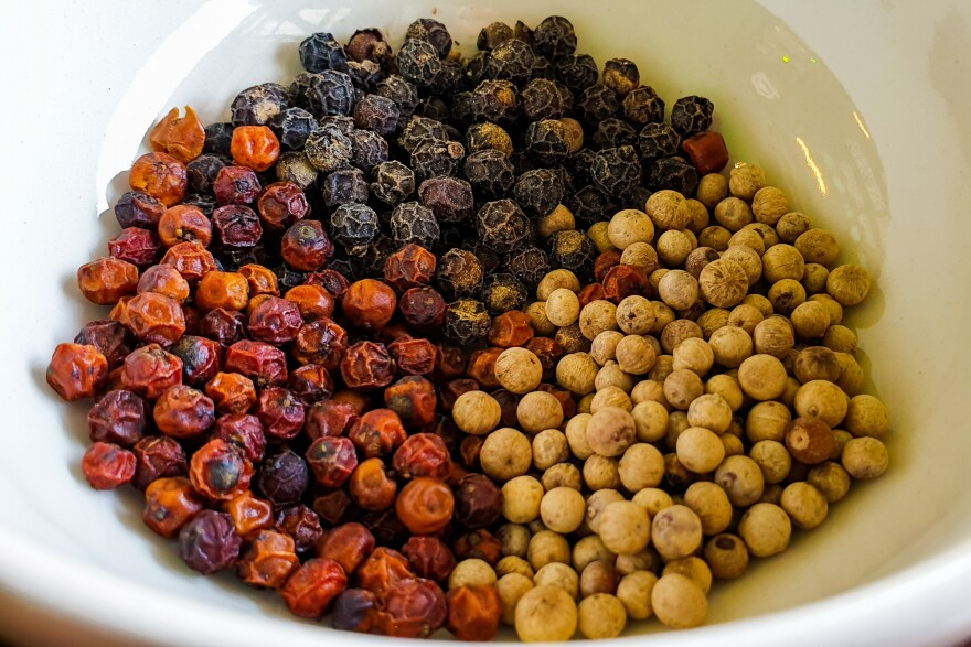An array of red, black and white peppercorns produced at Kampot's La Plantation.