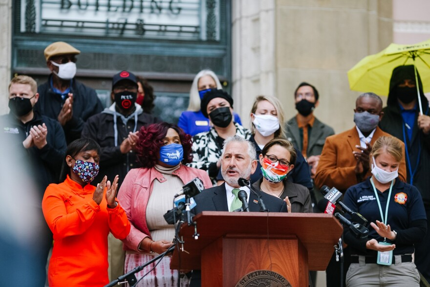 St. Petersburg Mayor Rick Kriseman surrounded by masked city officials as he introduced the Race to Safe campaign to prevent coronavirus spread.