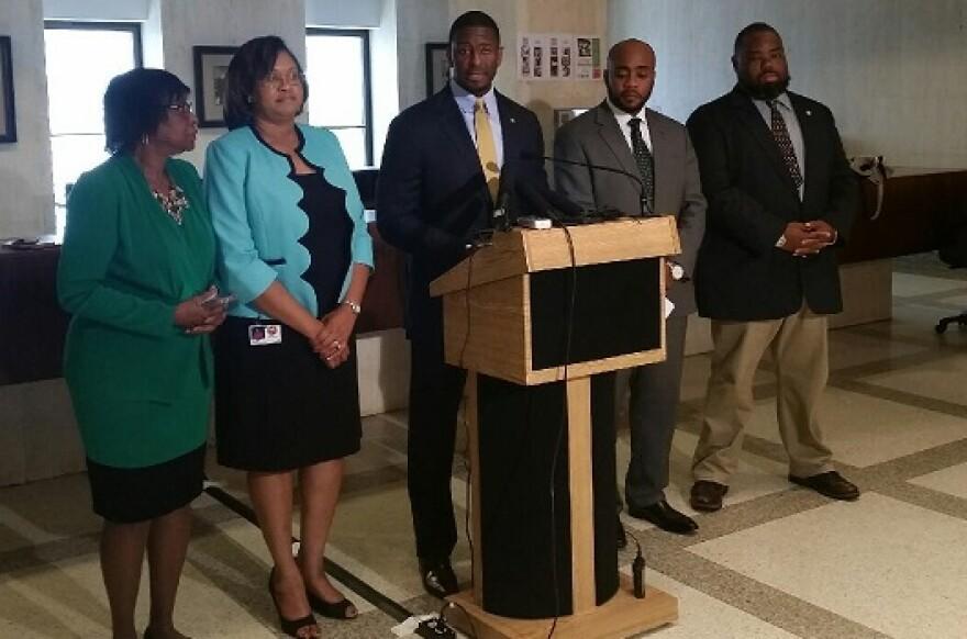 Tallahassee Mayor Andrew Gillum (center) with Sen. Arthenia Joyner (l), Rep. Mia Jones, Rep. Alan Williams and Sen. Dwight Bullard are requesting FAMU Board Chairman Rufus Montgomery relinquish his chairmanship.