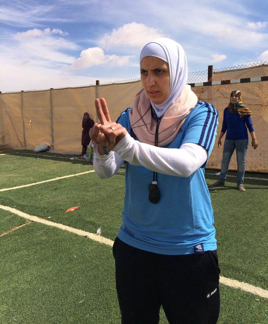 Reema Ramoniah coaches a woman's soccer league at the camp. The players come from conservative, rural families where soccer was considered something men did.