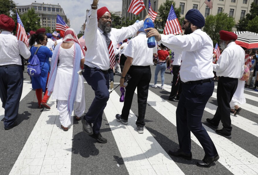 Members of the Sikhs of America dance as they take part in the National Independence Day Parade in Washington, D.C.