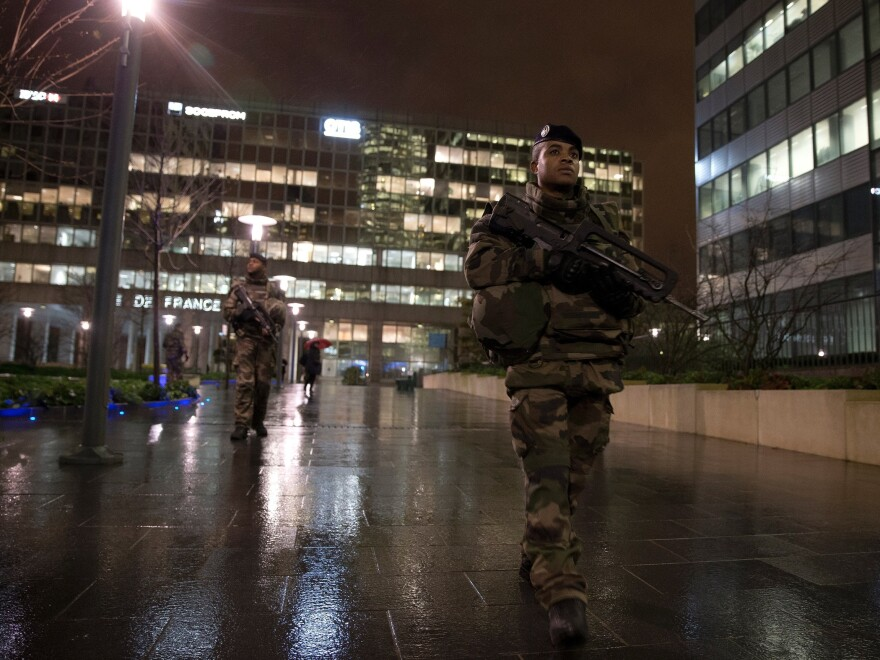 French soldiers patrol at Paris La Defense business district on Nov. 24, 2015 as part of security measures set following Nov. 13 Paris terror attacks.