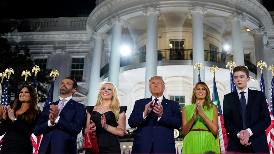 From left, Kimberly Guilfoyle, Donald Trump Jr., Tiffany Trump, President Donald Trump, first lady Melania Trump and Barron Trump stand on the South Lawn of the White House during the final night of the Republican National Convention.