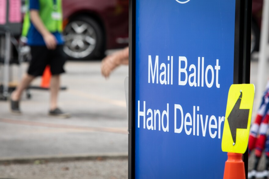 Travis County residents hand delivery mail-in ballots at the Travis County Tax Office on Airport Boulevard. Gov. Greg Abbott has limited Texas counties to only one drop-off location.