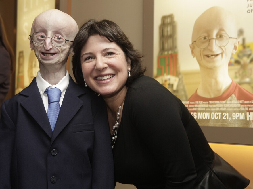 """Sam Berns and Audrey Gordon, executive director of The Progeria Research Foundation and Berns's aunt, attend The New York Premiere Of HBO's """"Life According To Sam"""" on October 8, 2013 in New York City."""