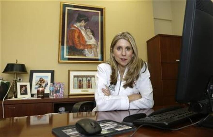 Dr. Judy Schaechter at her office at the University of Miami, Miller School of Medicine, in Miami.  she faces sharp limits under a 2011 Florida law in what she can say about guns in the home.