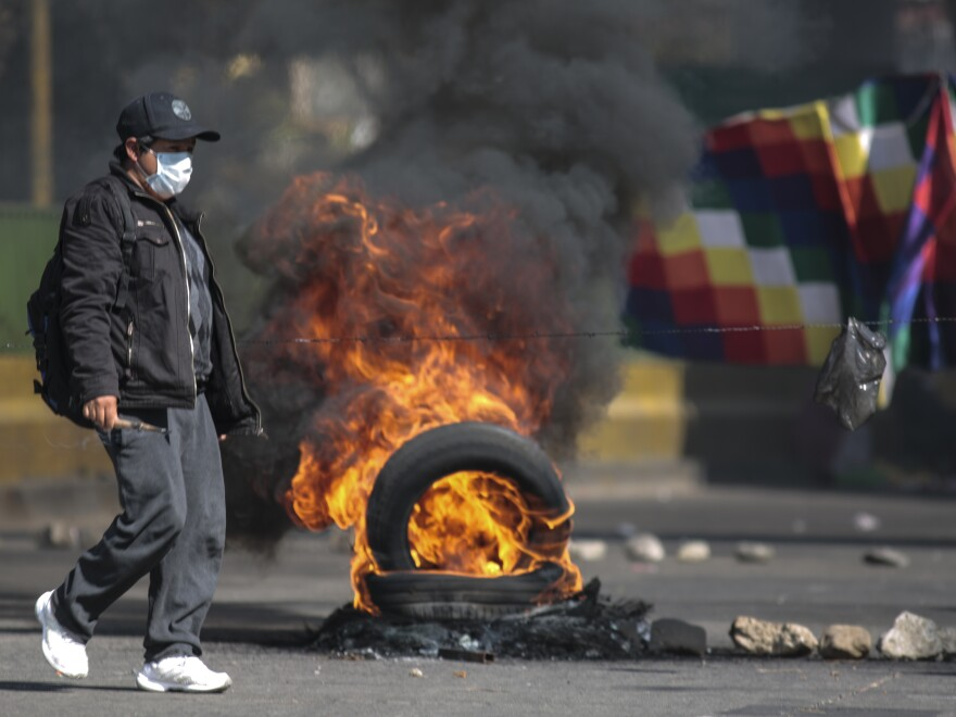 Demonstrators block roads to protest the postponement of presidential elections in El Alto, Bolivia.