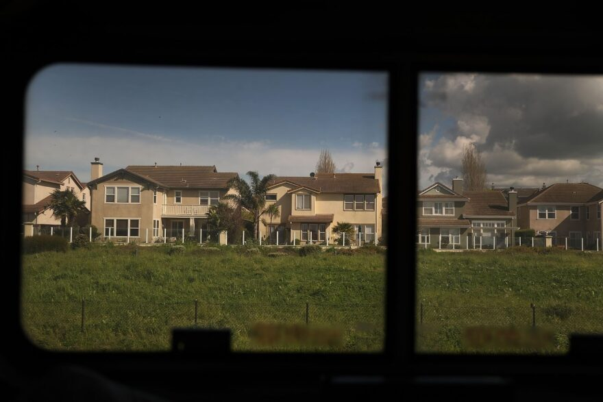 A suburban neighborhood is seen as Amtrak's California Zephyr comes close to the end of its daily 2,438-mile trip to Emeryville/San Francisco from Chicago.