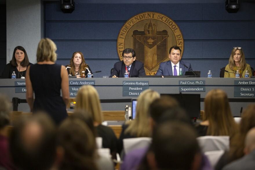 The school board listens to public testimony ahead of the closure vote.
