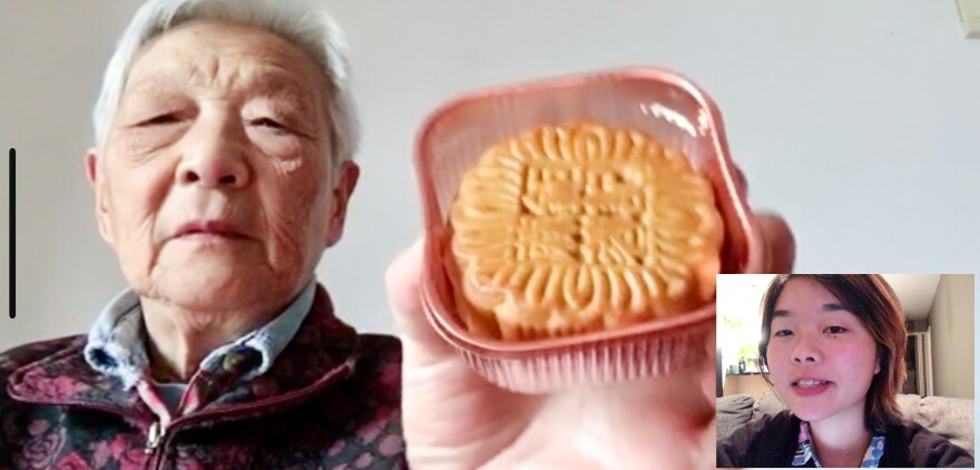 Nai holds a mooncake — a Chinese treat — up to the camera for her granddaughter.
