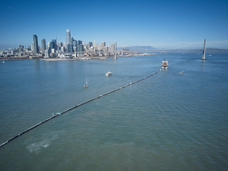 A nearly 2,000-foot-long tube is towed offshore from San Francisco Bay on Saturday. It's a giant garbage collector and the brainchild of 24-year-old Boyan Slat, who aims to remove 90 percent of ocean plastic by 2040.