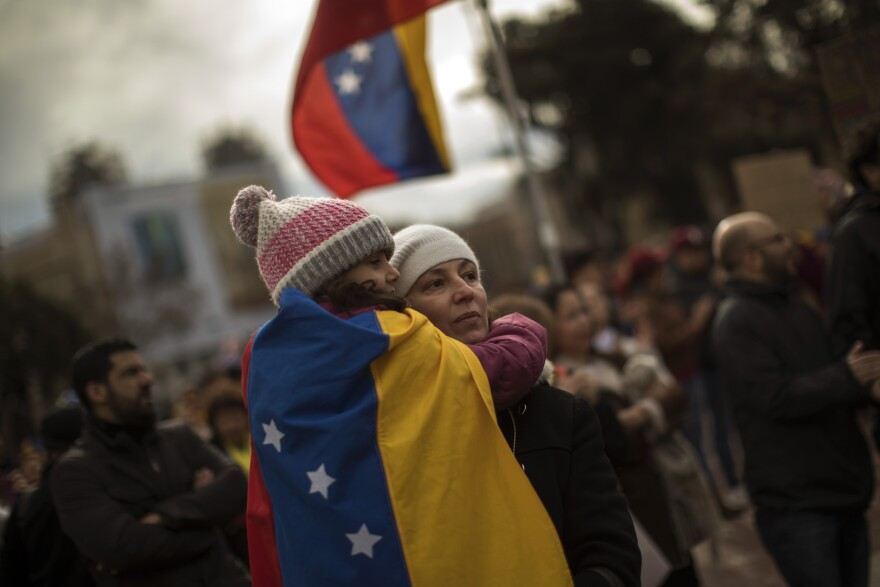 Venezuelans take part in a rally in Barcelona, Spain, on Feb. 2 to show support for the movement to push Venezuela's President Nicolás Maduro out of office.