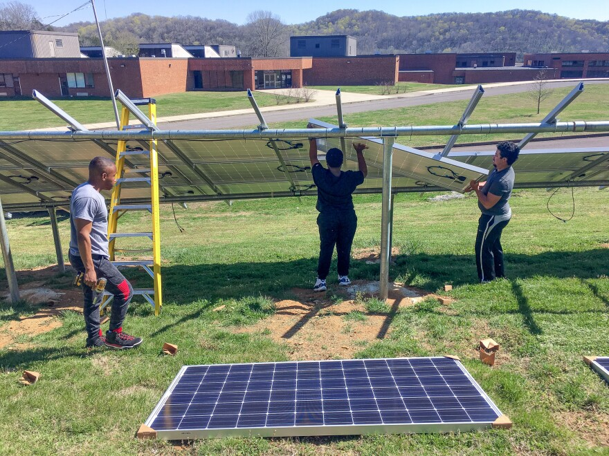 Whites Creek High School seniors Daniel Van Clief (left) and Kelando Rogan (center) are joined by Michael MacMiller, a regional organizer for the Southern Alliance for Clean Energy. All three consider Carney a mentor.