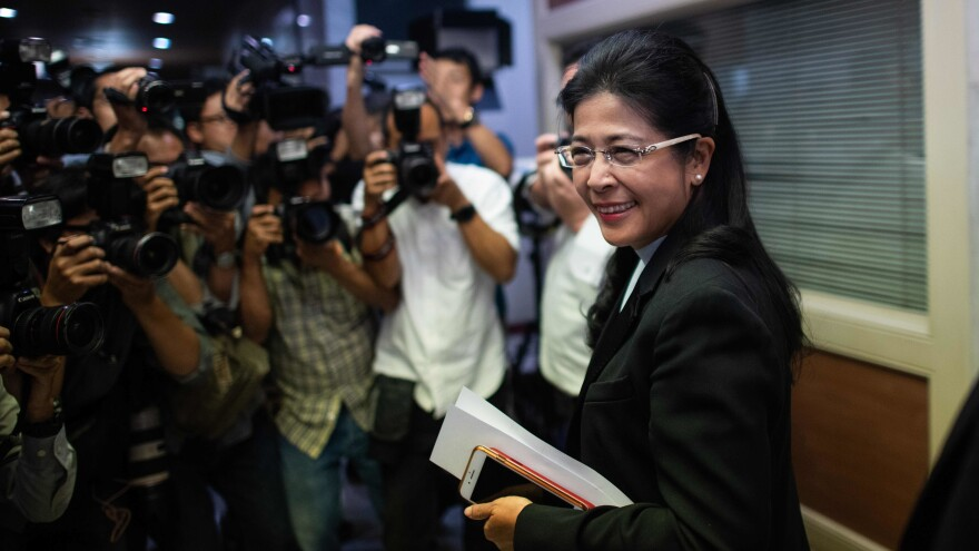 Thailand's major parties are vying to control its government, after mixed tallies in early election results. Here, Sudarat Keyuraphan, the Pheu Thai party's prime minister candidate, is seen after a news conference in Bangkok Monday.
