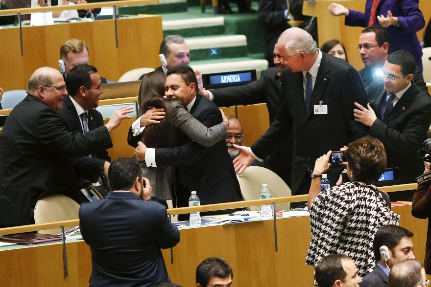 U.N. representatives for Venezuela, including Foreign Minister Rafael Ramirez, right, celebrate after being elected to a two year term as a non-permanent member of the United Nations Security Council on Thursday.