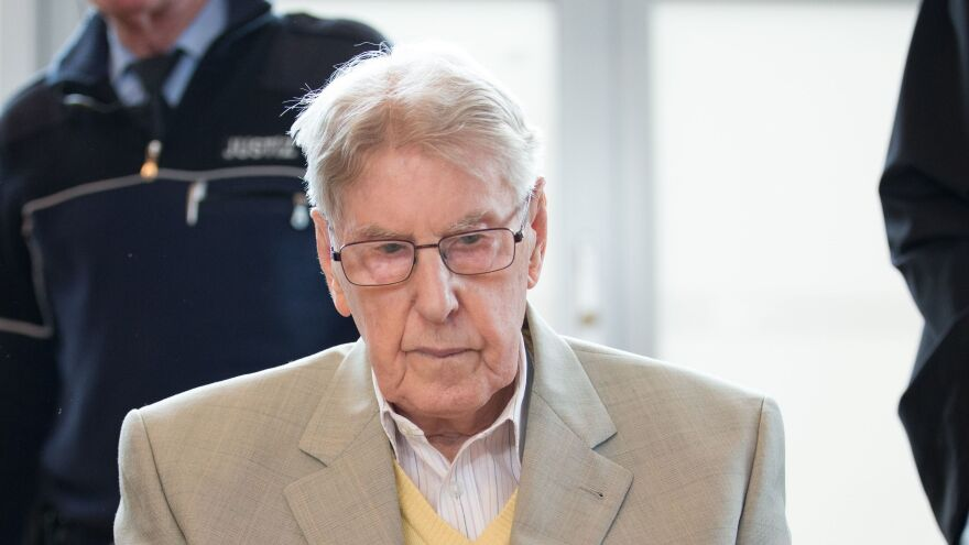 Former Auschwitz guard Reinhold Hanning apologized during his trial for failing to take action against the injustice he witnessed.