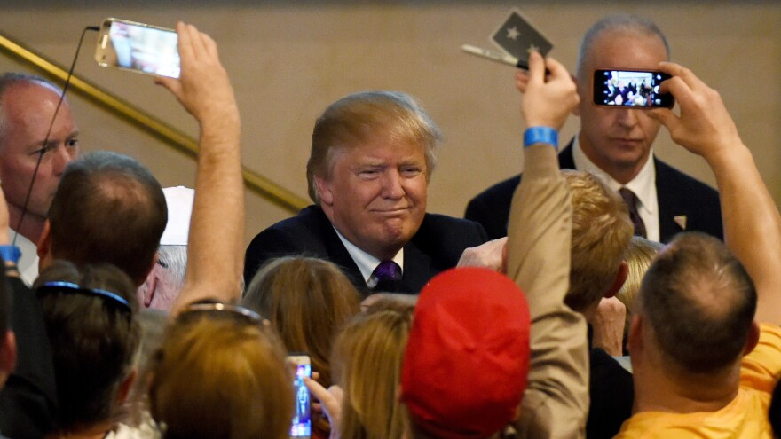 Donald Trump greets supporters after speaking at a caucus night watch party at the Treasure Island Hotel & Casino in Las Vegas. Trump is favored to do well Super Tuesday.