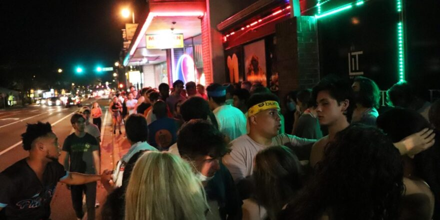 college students in line outside bar