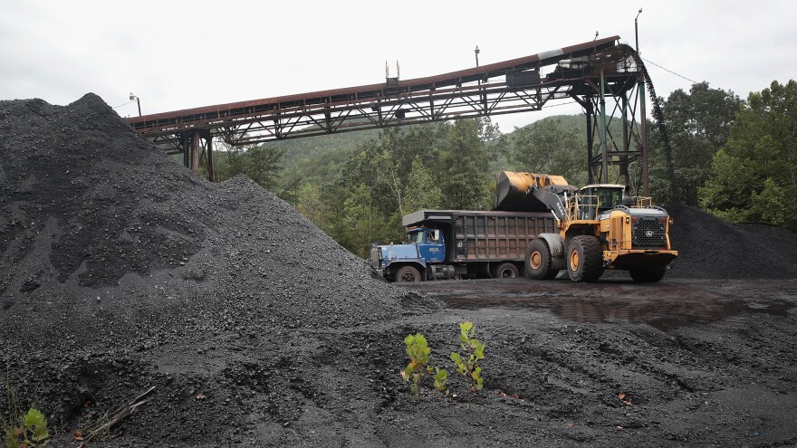 A truck is loaded with coal at a mine on August 26, 2019 near Cumberland, Kentucky.