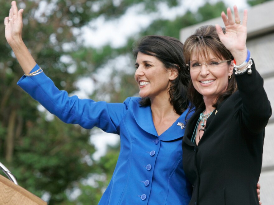 Former Alaska Gov. Sarah Palin and then-gubernatorial candidate Nikki Haley (left) attend a 2010 rally in Columbia, S.C.