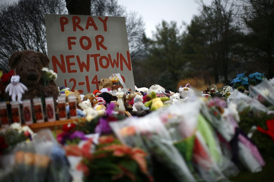 Flowers, candles and stuffed animals make up a makeshift memorial in Newtown, Conn., on Monday. Much of the initial news coverage of Friday's events was later found to be inaccurate.