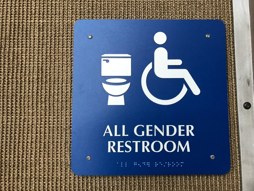 Gender-neutral bathroom sign at the Austin-Bergstrom Airport in Austin.