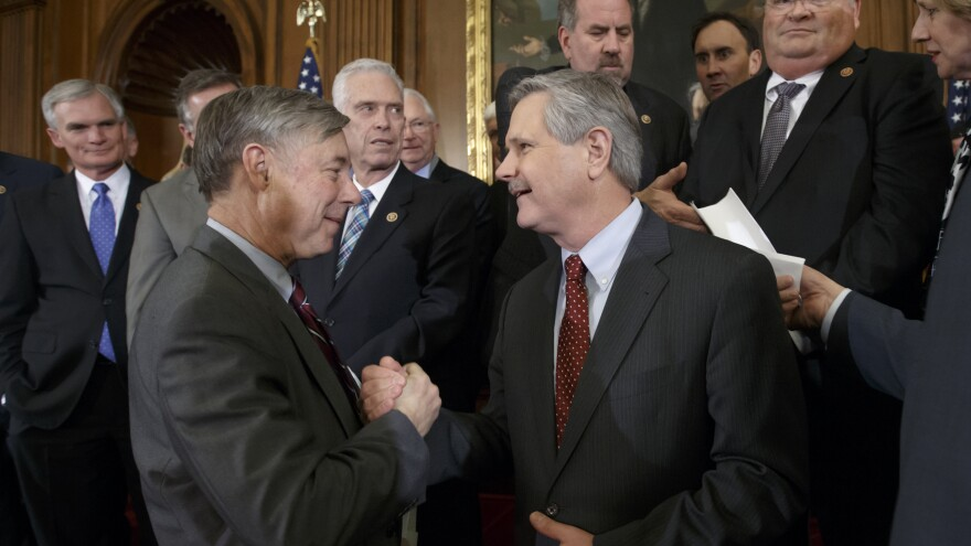 House Energy and Commerce Committee Chairman Fred Upton, R-Mich., left, clasps hands with Sen. John Hoeven, R-N.D., sponsor of the Senate's Keystone XL pipeline bill version, on Wednesday as lawmakers gather to urge President Obama to sign the legislation approving expansion of the Keystone XL pipeline. The House passed the Senate's version of the bill Wednesday afternoon.