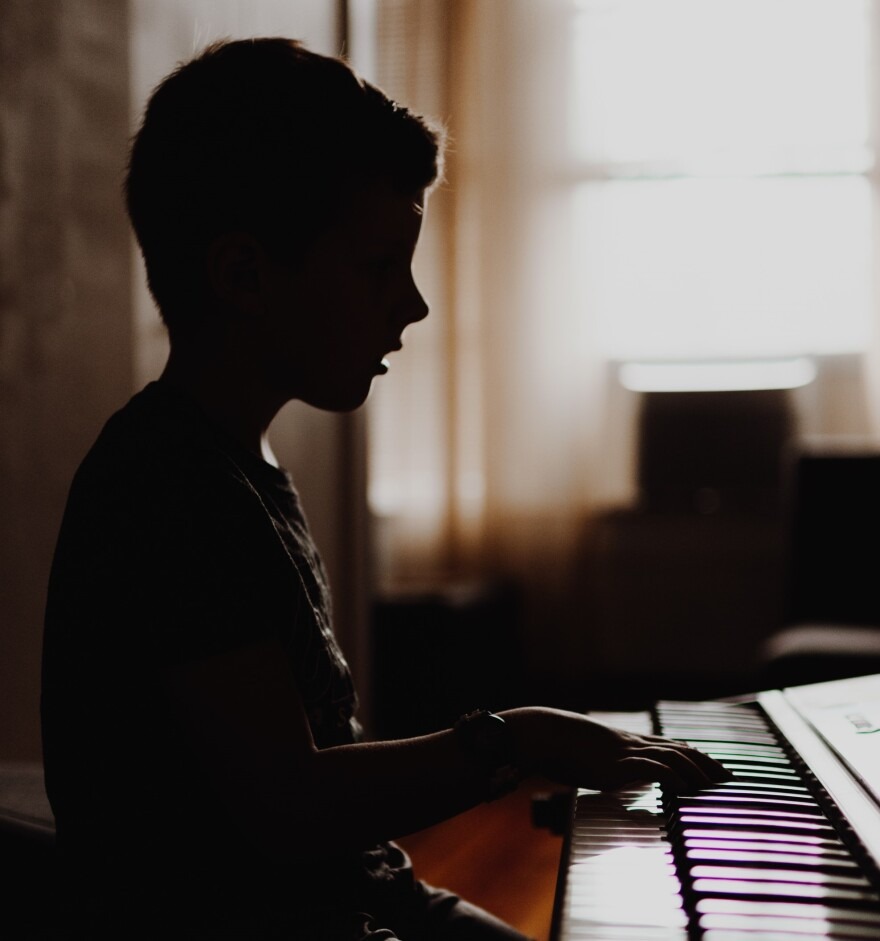 Child plays piano