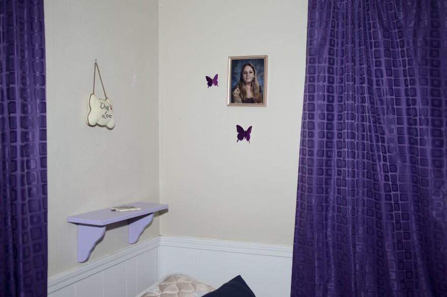 Crystal Kirk, 12, keeps a framed photo of her mother, Amber Kirk, above her bed in her home in Mulvane, Kan. Crystal and her two siblings have lived with their grandmother since 2011, when their mother was given a life sentence for possession <strong> </strong>and endeavoring to manufacture methamphetamine.