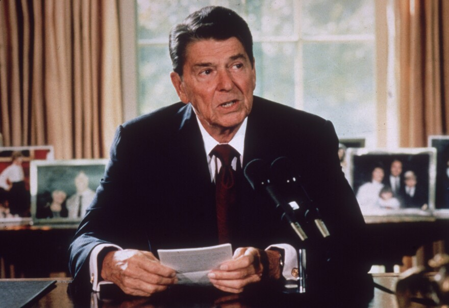 President Ronald Reagan makes an announcement from his desk at the White House in Washington, D.C. in 1985. Reagan implemented tax cuts during his time in office. (Hulton Archive/Getty Images)