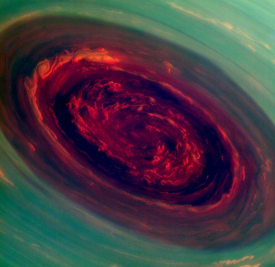 "A mammoth spinning vortex is seen on Saturn, in this ""false-color"" photograph released by NASA Monday. The image was captured by the Cassini spacecraft. A related image, presenting what a human eye would see, is farther down this page."