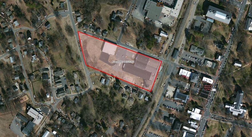 Red area is the old mill property, with asbestos buried to the left and the old mill building to the right. Depot Street is at the top next to the mill.