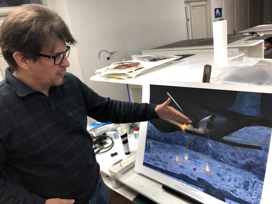 South Carolina artist Dru Blair shows a print of his painting of a 1952 CIA operation in China in which U.S. two pilots were killed. Blair painted several paintings for the agency's official collection.