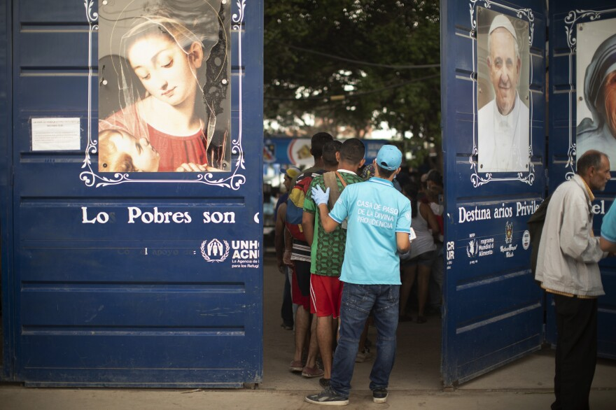 People file into Casa de Paso Divina Providencia, a Catholic charity kitchen that feeds thousands of Venezuelans in the Colombian border zone.
