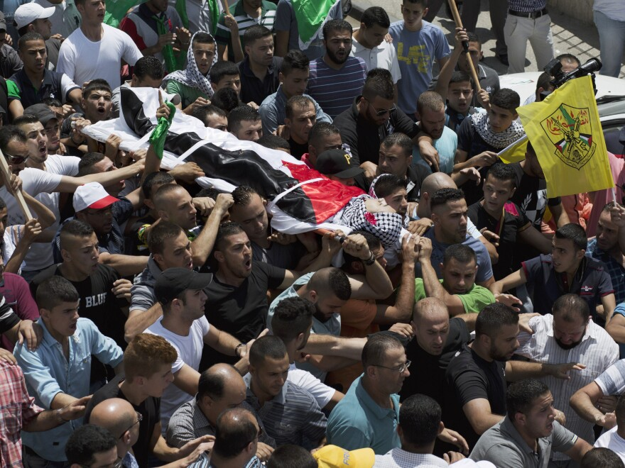 Mourners carry the body of Palestinian Laith al-Khaldi during his funeral procession at the Jalazoun refugee camp, near the West Bank city of Ramallah, on Aug. 1, 2015. An Israeli soldier shot Khaldi after he had been throwing rocks at a military post. This was during a relatively calm period, although almost two dozen Palestinians were killed during the first half of the year.