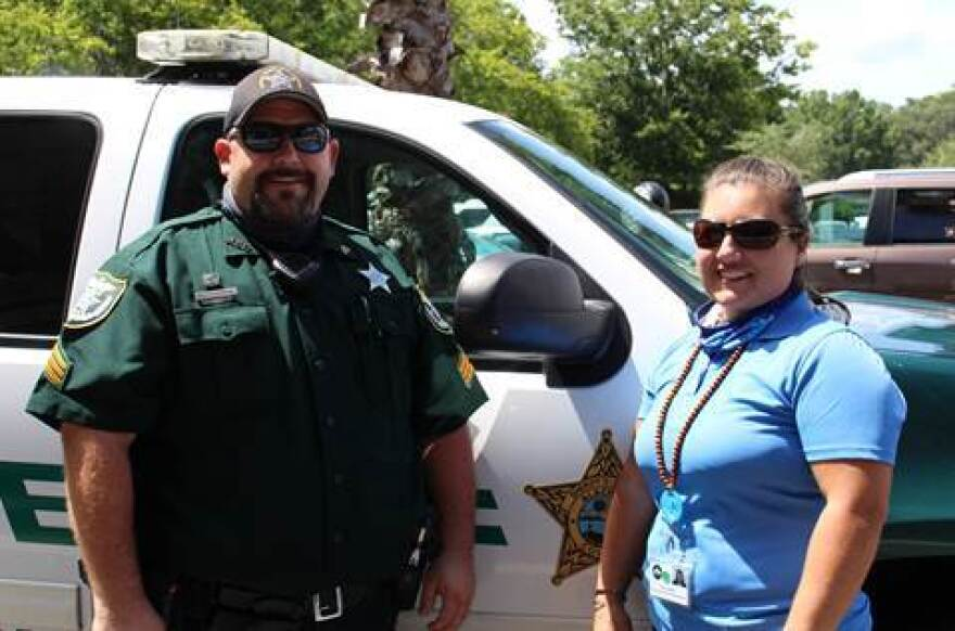 Sgt. Paul Pardue  stands with Briana Kelley, of Meridian Behavioral Healthcare.. Not pictured is Deputy Daniel Maynard, Kelley's partner on the co-responder team.