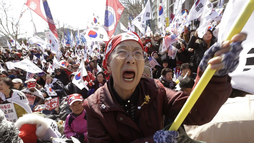 A supporter cries during a rally opposing President Park Geun-hye's impeachment near the Constitutional Court in Seoul, South Korea, on Friday.