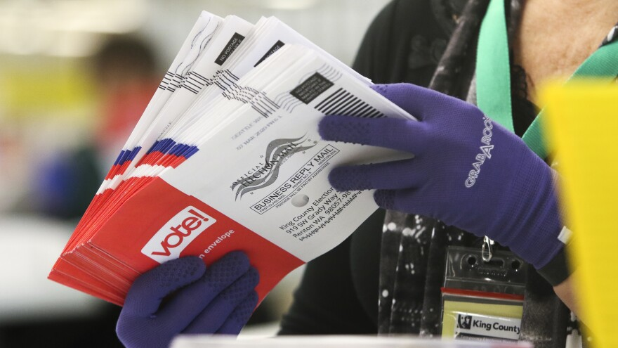An election worker sorts vote-by-mail ballots for Washington state's presidential primary on March 10 in Renton, a suburb of Seattle.